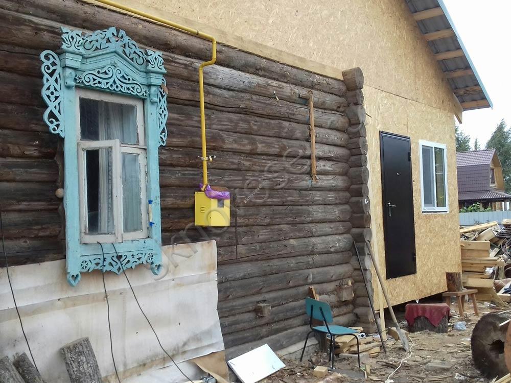 Строительство каркасной пристройки к деревянному дому